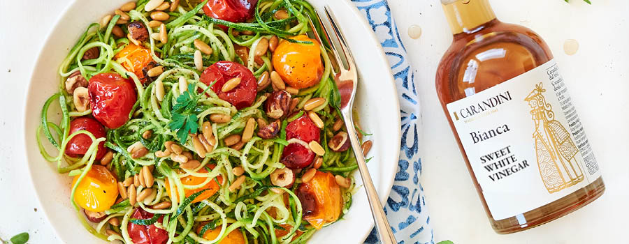 Courgette Spaghetti, plum tomato and nut summer salad with Sweet White Vinegar