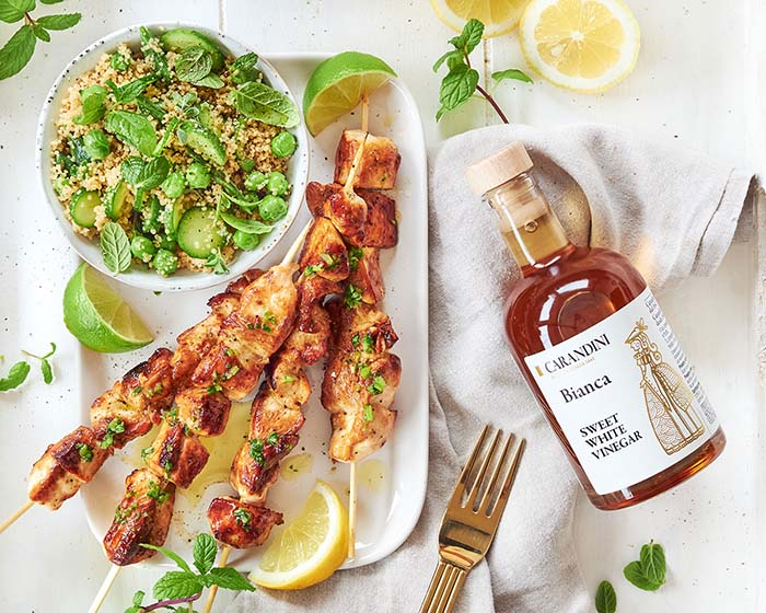 Grilled marinated chicken skewers with Carandini Sweet White Vinegar and couscous salad